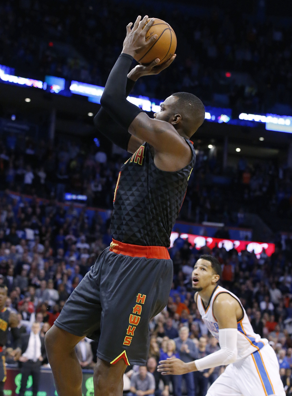 Atlanta Hawks forward Paul Millsap, left, shoots with 12.7 seconds left in front of Oklahoma City Thunder forward Andre Roberson, right...