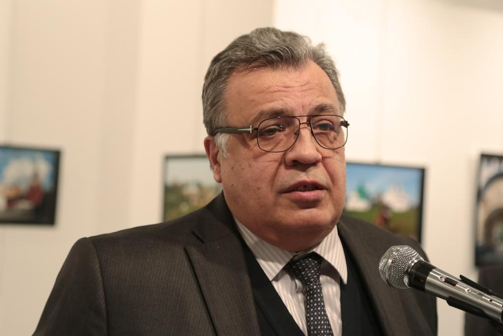 The Russian Ambassador to Turkey Andrei Karlov speaks a gallery in Ankara Monday Dec. 19, 2016. A gunman opened fire on Russia's ambass...