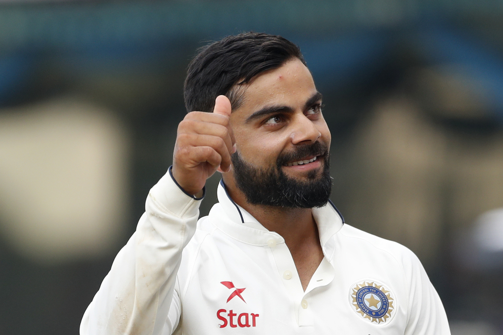 Indian cricket captain Virat Kohli raises his thumb after winning the test series against England during their fifth day of the fifth c...