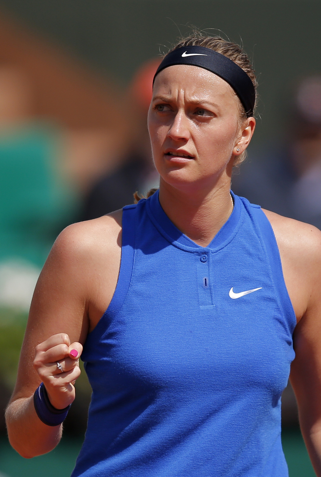 FILE - In this May 25, 2016 file picture Petra Kvitova of the Czech Republic reacts as she plays Taiwan's Su-Wei Hsieh during their sec...