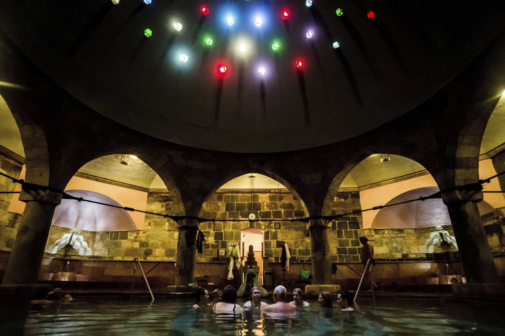 FILE - In this March 20, 2016 file photo visitors enjoy a bath in a pool of Rudas Thermal Bath and Swimming Pool in Budapest, Hungary. ...