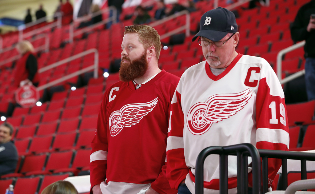 Detroit Red Wings fans look out over the ice following the cancellation of the Red Wings game with the Carolina Hurricanes due to a pro...