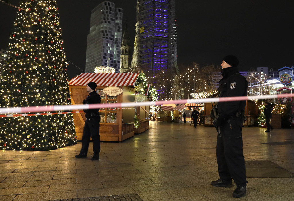 Police guard a Christmas market after a truck ran into the crowded Christmas market in Berliin Berlin, Germany, Monday, Dec. 19, 2016. ...
