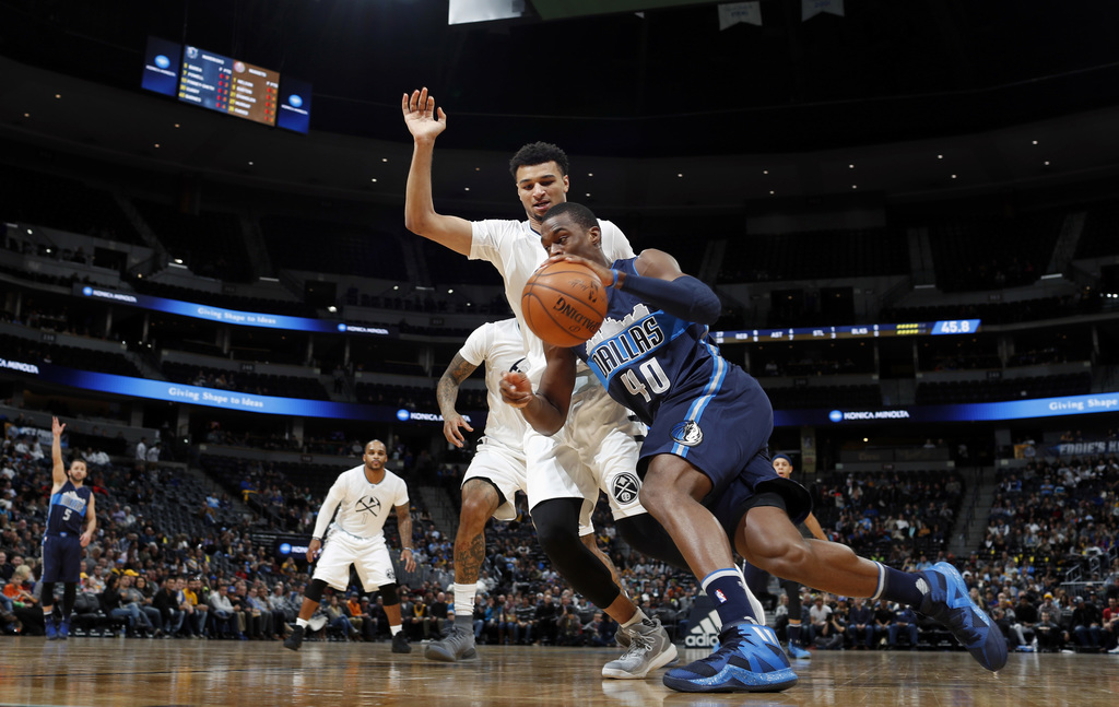 Dallas Mavericks forward Harrison Barnes, front, drives to the basket past Denver Nuggets guard Jamal Murray in the first half of an NB...