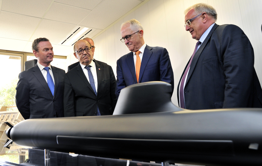 Australian Prime Minister Malcolm Turnbull, second right, stands with French Defense Minister Jean-Yves Le Drian, second left, Australi...
