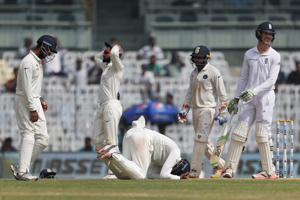 India's Lokesh Rahul, center, reacts after missing a catch as England's Keaton Jennings, right, smiles during their fifth day of the fi...