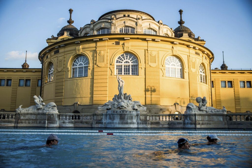 FILE - In this March 21, 2016 file photo visitors swim in an outdoor pool of Szechenyi Thermal Bath and Swimming Pool in Budapest, Hung...