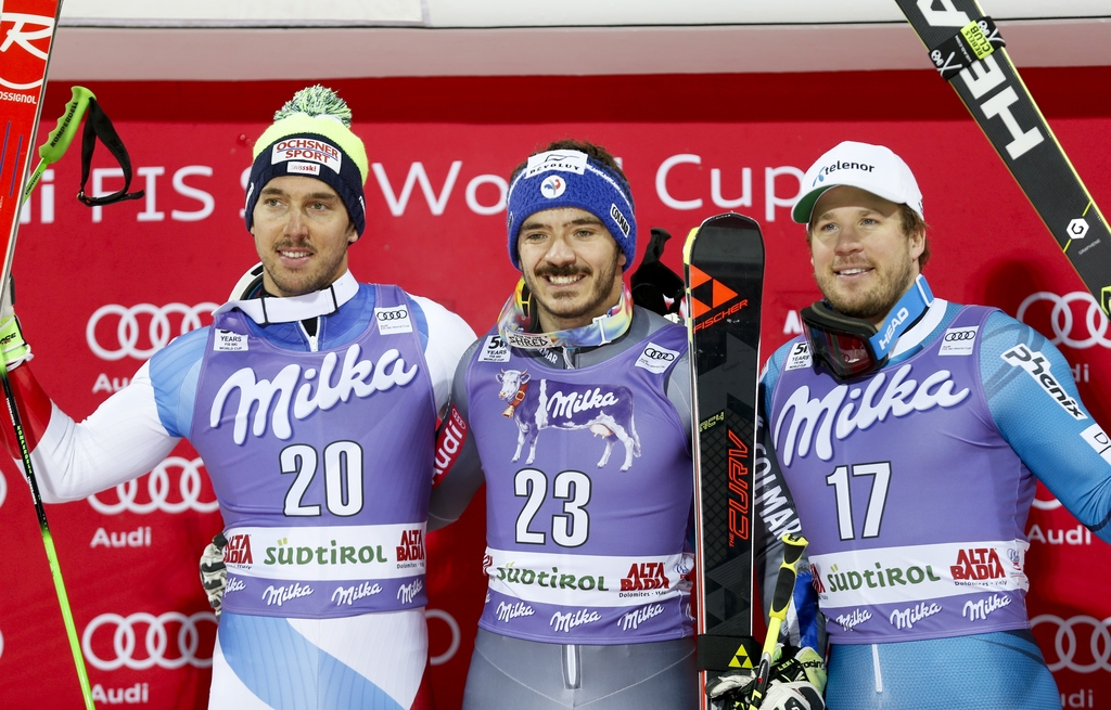 France's Cyprien Sarrazin, center, winner of an alpine ski, men's World Cup giant slalom, poses with second placed Switzerland's Carlo ...