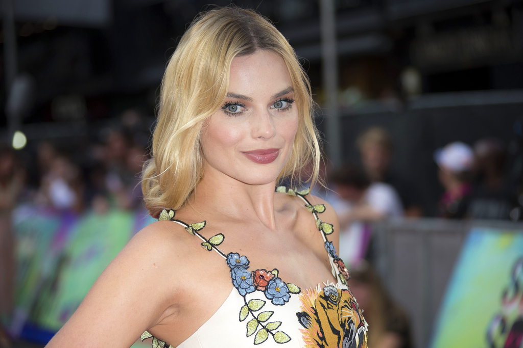 """FILE - In this Aug. 3, 2016 file photo, actress Margot Robbie poses for photographers upon arrival at the European Premiere of """"Suicide..."""