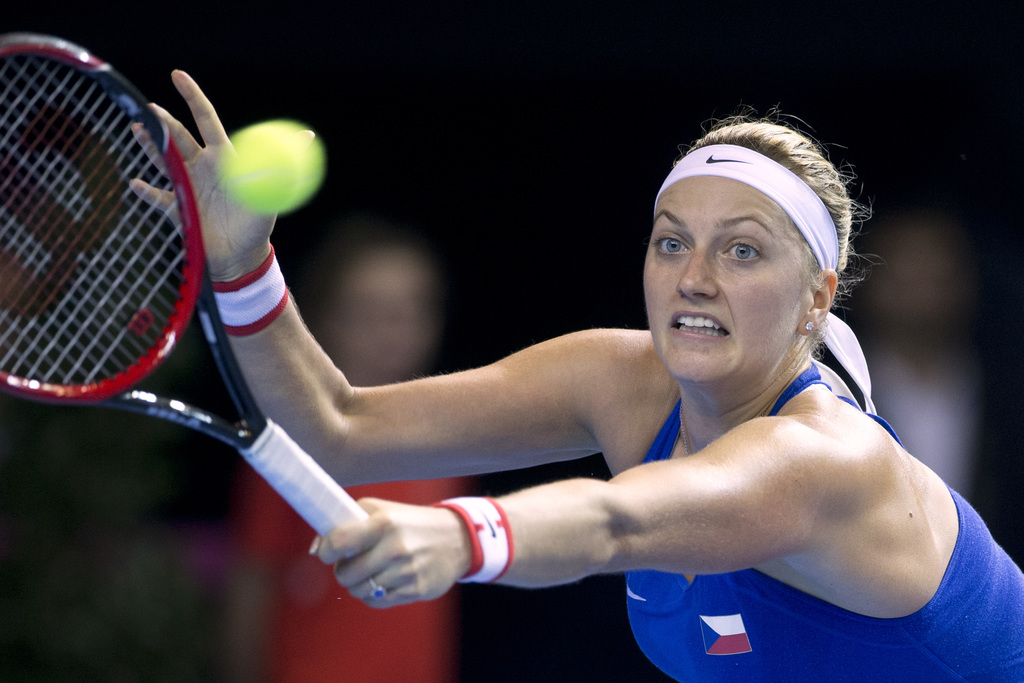 FILE - In this Nov. 12, 2016 file picture Czech Republic's Petra Kvitova returns the ball to France's Caroline Garcia during the Fed Cu...