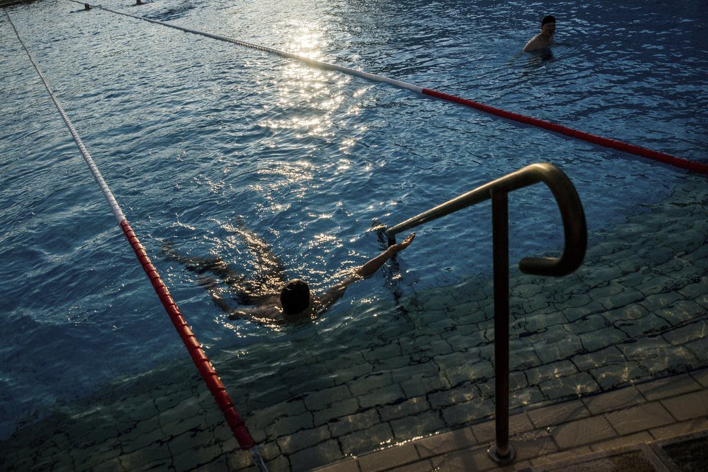 FILE - In this March 21, 2016 file photo visitors enjoy a bath in a pool of Szechenyi Thermal Bath and Swimming Pool in Budapest, Hunga...