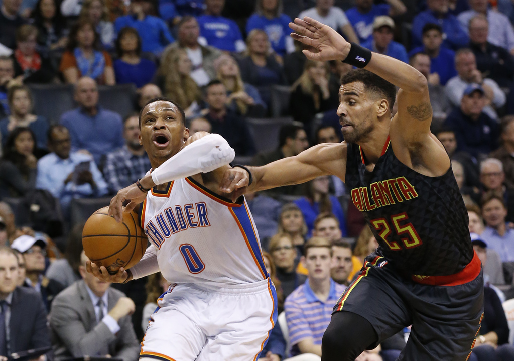 Oklahoma City Thunder guard Russell Westbrook (0) drives around Atlanta Hawks forward Thabo Sefolosha (25) in the second quarter of an ...