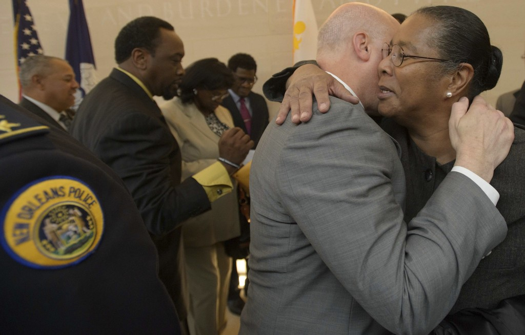 New Orleans Mayor Mitch Landrieu, center right, hugs Jackie Madison Brown, whose brother Ronald Madison was killed by New Orleans Polic...