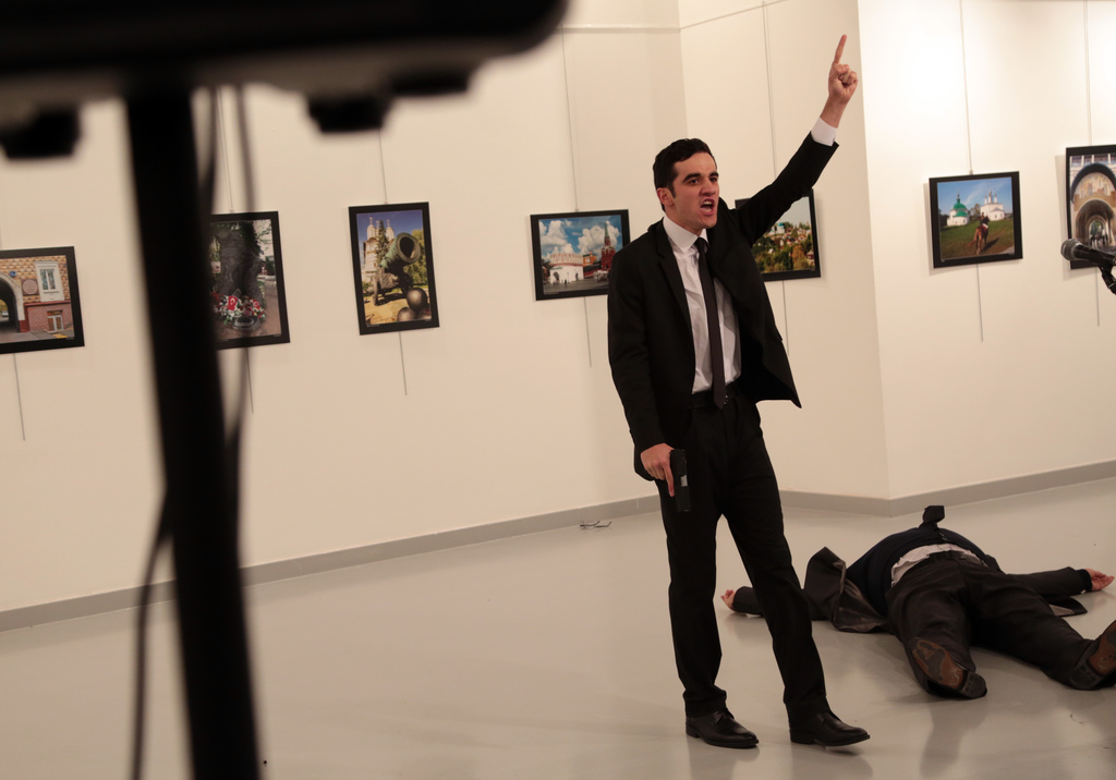 ADDS THE NAME OF THE GUNMAN - A man identified as Mevlut Mert Altintas shouts after shooting Andrei Karlov, the Russian Ambassador to T...