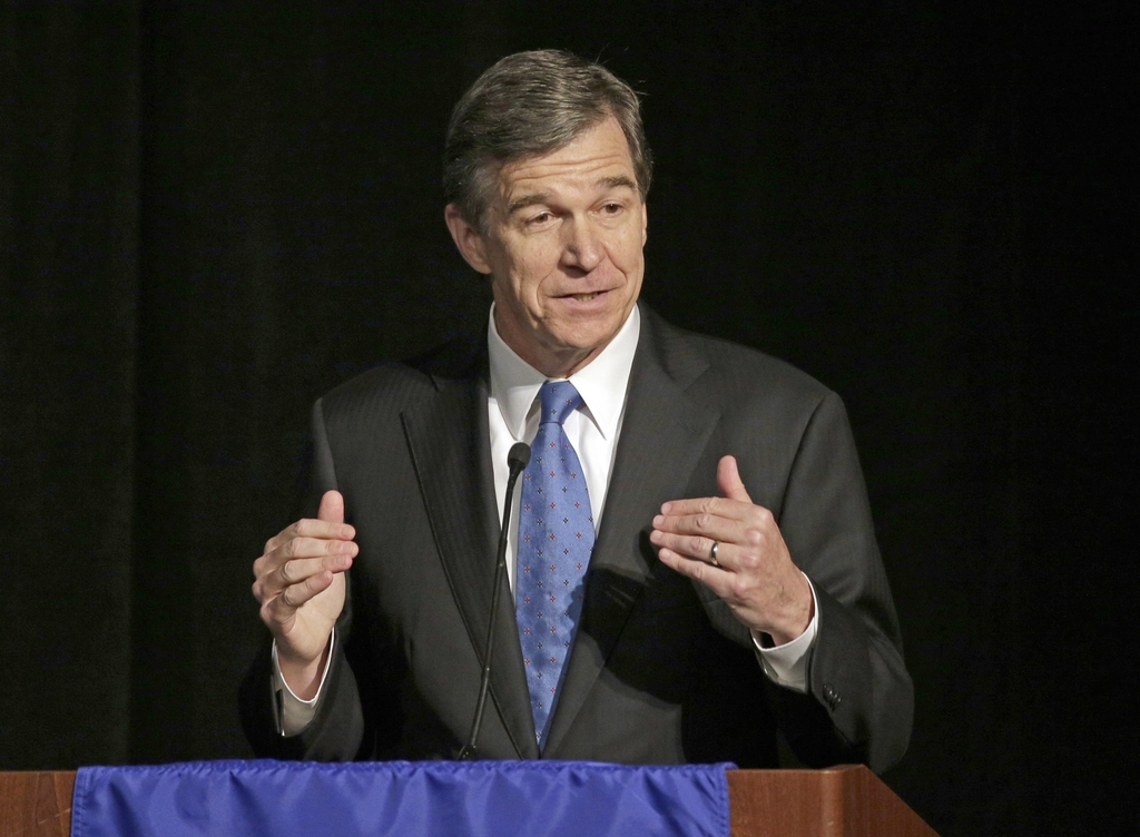 FILE - In this June 24, 2016, file photo, North Carolina Attorney General Roy Cooper speaks during a forum in Charlotte, N.C. North Car...