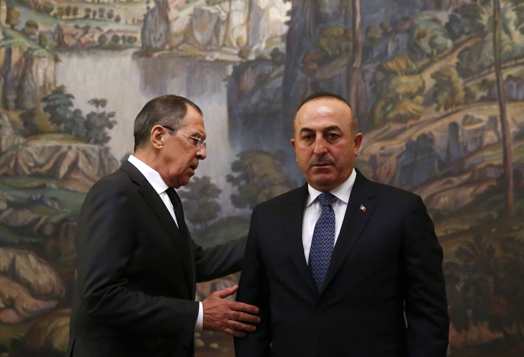 Russian Foreign Minister Sergey Lavrov, right, and Turkey's Foreign Minister Mevlut Cavusoglu attend a ceremony in memory of Russian Am...