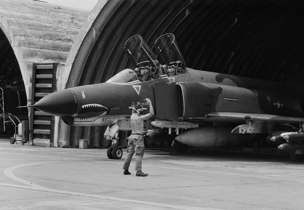 FILE - In this April 23, 1966 file photo a U.S. Air Force F-4 Phantom jet is guided out of its revetment in Da Nang formerly South Viet...