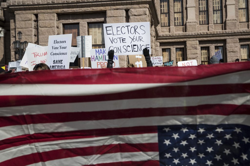 Demonstrators gather outside the Texas State Capitol in an attempt to influence the Republican electors from across the state to not vo...