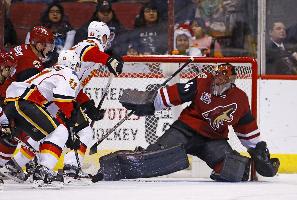 Calgary Flames center Mikael Backlund (11) scores a goal against Arizona Coyotes goalie Mike Smith (41) as Flames center Sam Bennett (9...
