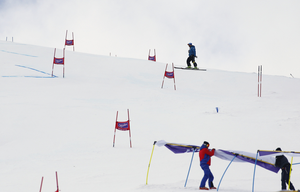 People work on the course of an alpine ski, women's World Cup giant slalom in Courchevel, France, Tuesday, Dec. 20, 2016. The race was ...