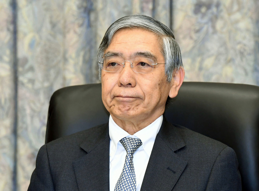 Bank of Japan Gov. Haruhiko Kuroda attends a meeting at the central bank headquarters in Tokyo Tuesday, Dec. 20, 2016. Japan's central ...