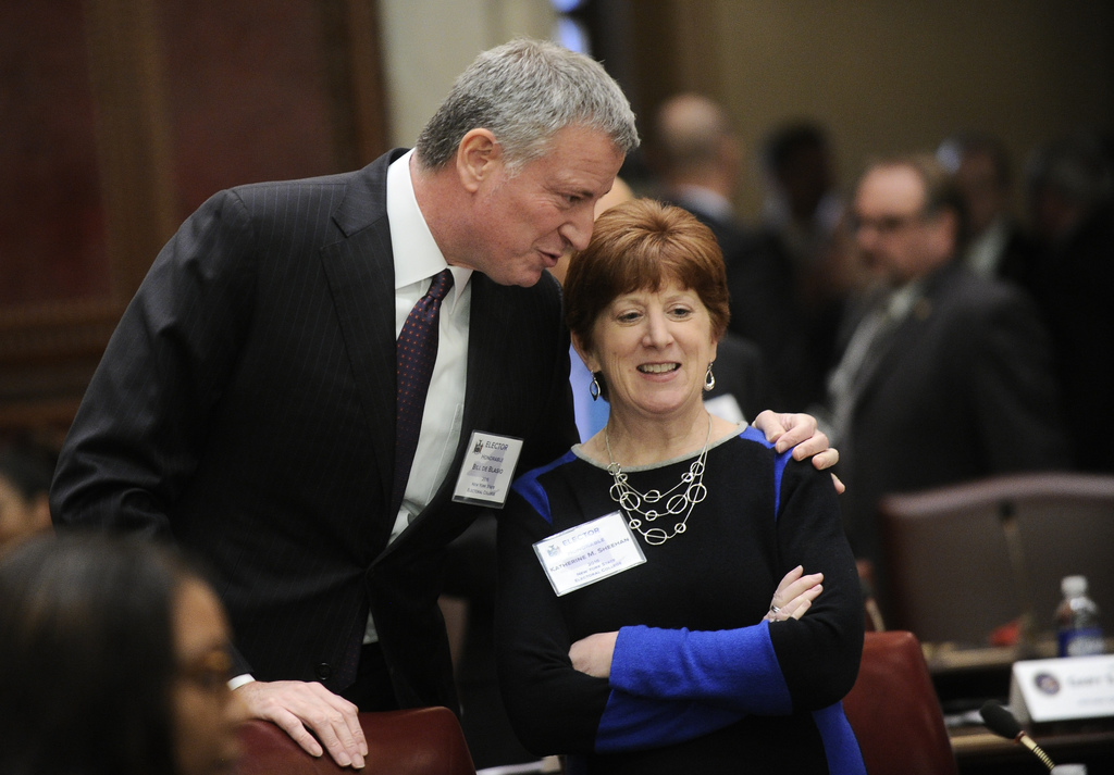 New York City Mayor Bill de Blasio, left, and Albany Mayor Katherine M. Sheehan talk as members of New York state's Electoral College m...