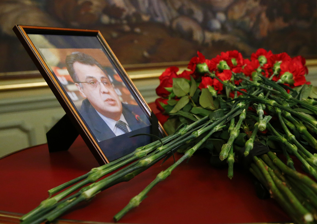 Flowers lay next to a portrait in memory of Russian Ambassador to Turkey Andrei Karlov, who was fatally shot by a Turkish policeman Mon...