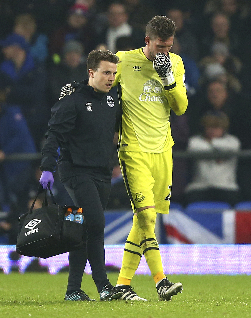 Everton's goalkeeper Maarten Stekelenburg, right, is helped from the pitch after getting injured during the English Premier League socc...