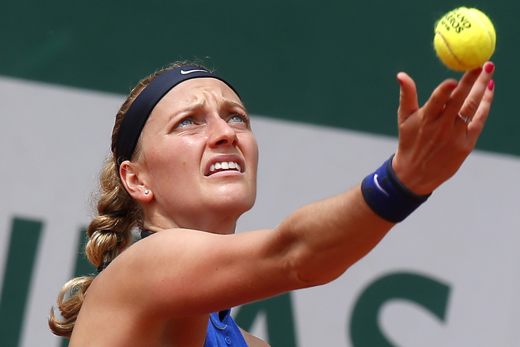 FILE - In this May 27, 2016 file photo, Petra Kvitova of the Czech Republic serves in her third round match of the French Open tennis t...