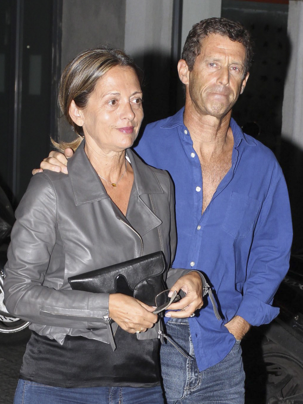 In this photo taken Friday, Oct. 8, 2010, Beny Steinmetz and his wife arrive to a party in Tel Aviv, Israel. Israeli police on Monday a...