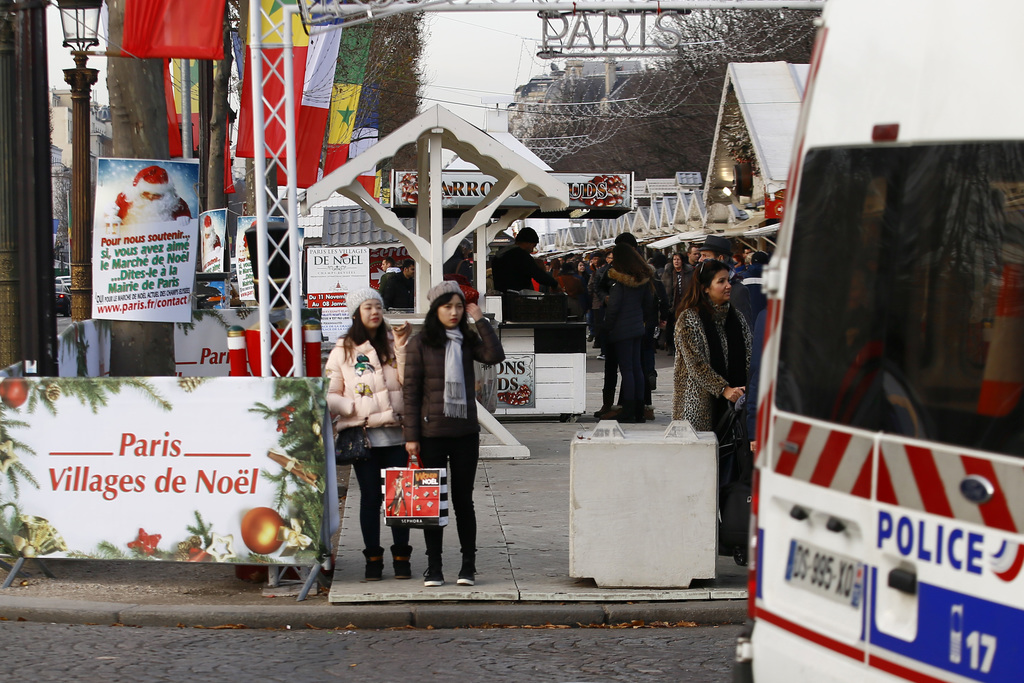A french Police truck patrols in the Champs Elysee Avenue Christmas market in Paris, Tuesday, Dec. 20, 2016 the day after a truck ran i...