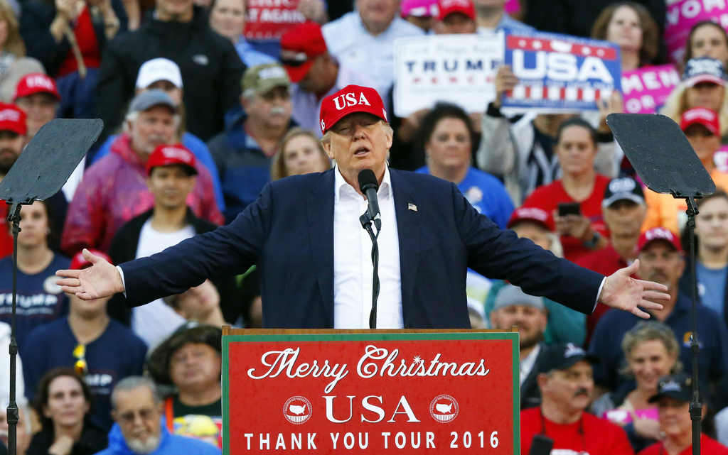 In this Dec. 17, 2016, photo, President-elect Donald Trump speaks during a rally at the Ladd–Peebles Stadium in Mobile, Ala. Trump will...