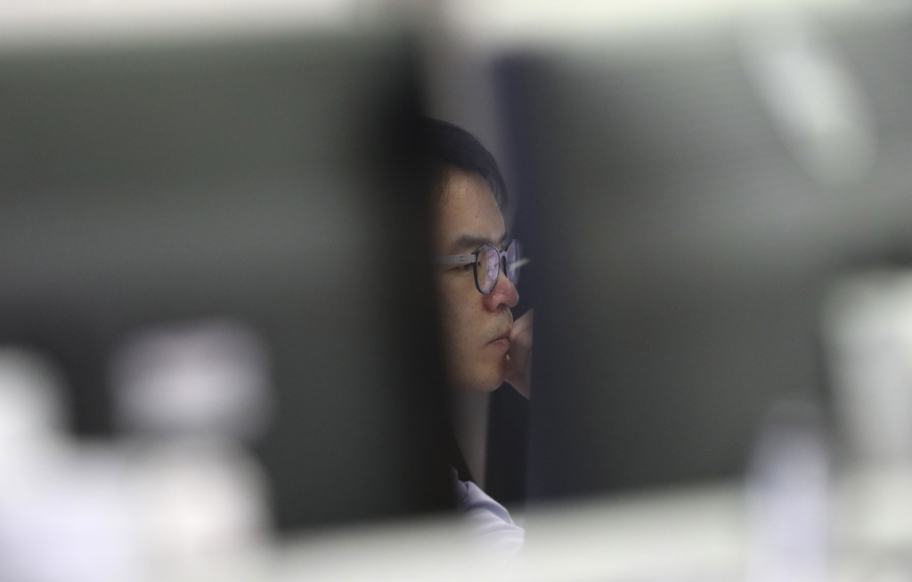 A currency trader watches monitors at the foreign exchange dealing room in Seoul, South Korea, Tuesday, Dec. 20, 2016. Asian markets me...