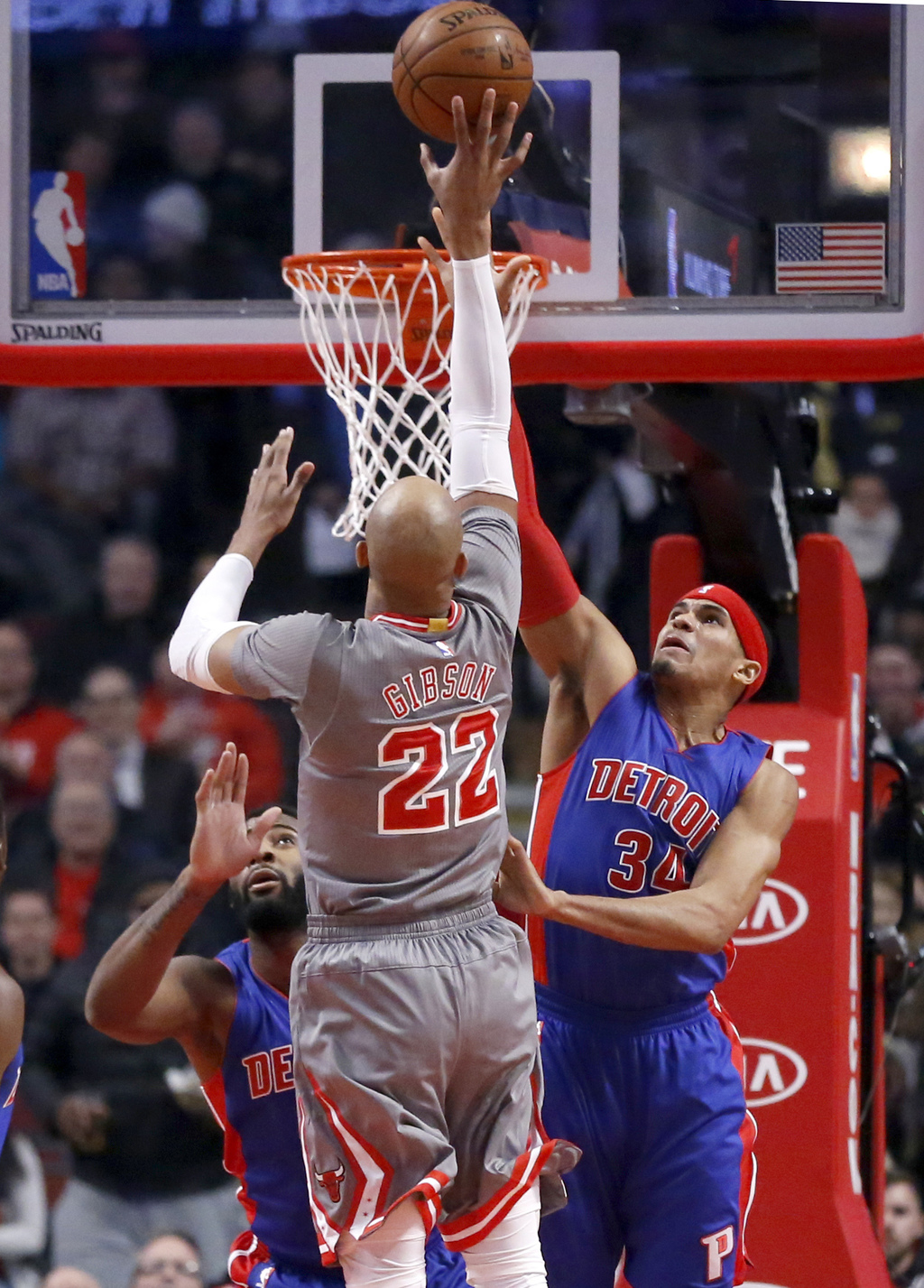 Detroit Pistons' Tobias Harris, right, defends on a shot by Chicago Bulls' Taj Gibson (22) during the first half of an NBA basketball g...