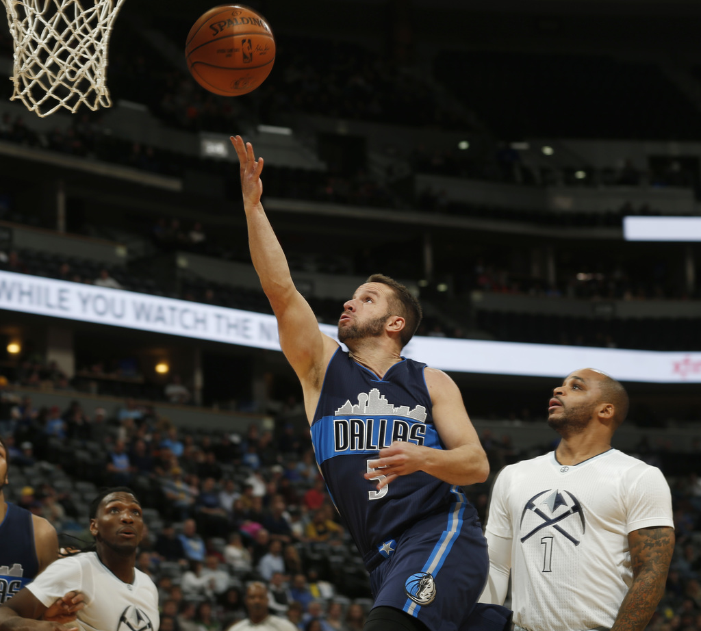 Dallas Mavericks guard J.J. Barea, left, shoots past Denver Nuggets guard Jameer Nelson in the first half of an NBA basketball game Mon...