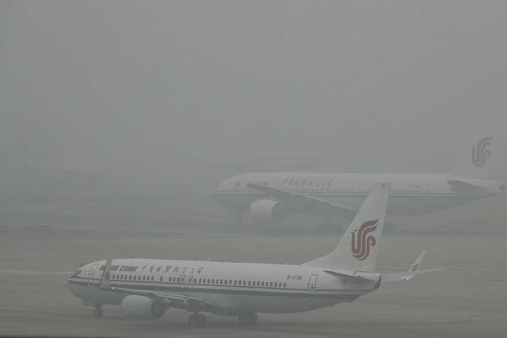 Air China passenger planes preparing to take off at the Beijing Capital International Airport as the capital of China is shrouded by he...