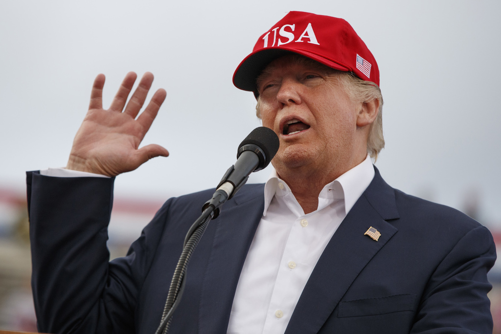 FILE - In this Saturday, Dec. 17, 2016, file photo, President-elect Donald Trump speaks during a rally at Ladd-Peebles Stadium in Mobil...