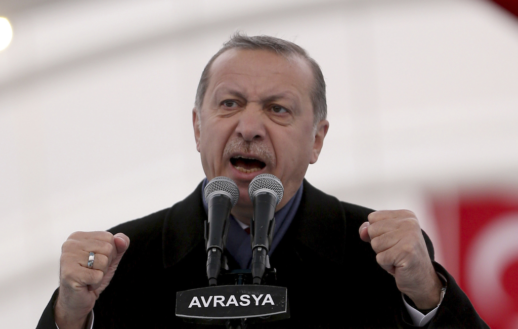 Turkey's President Recep Tayyip Erdogan gestures as he speaks during the opening ceremony of Eurasia Tunnel in Istanbul, Tuesday, Dec, ...