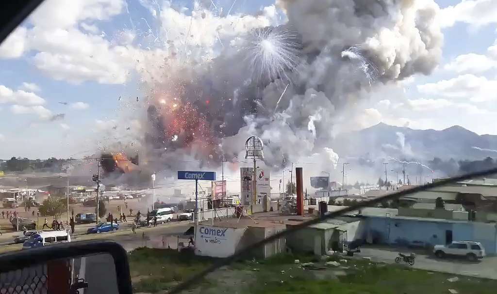 This image made from video recorded from a passing car shows an explosion ripping through the San Pablito fireworks' market in Tultepec...