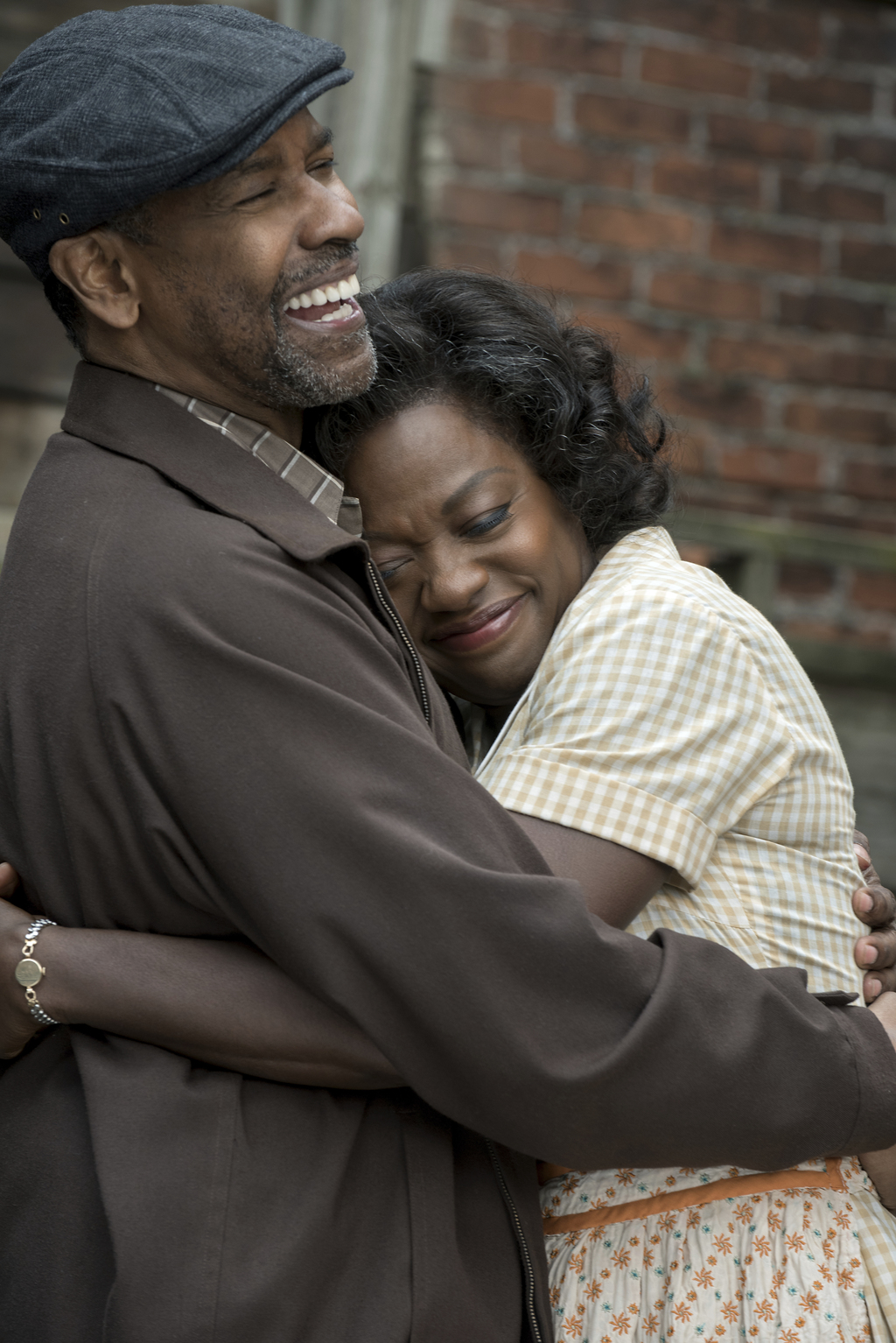 """This image released by Paramount Pictures shows Denzel Washington, left, and Viola Davis in a scene from """"Fences."""" (David Lee/Paramount..."""