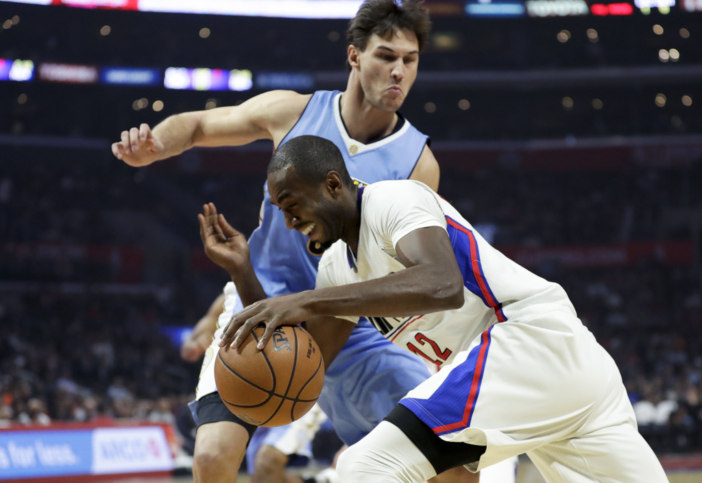 Los Angeles Clippers forward Luc Mbah a Moute, drives to the basket past Denver Nuggets forward Danilo Gallinari during the first half ...