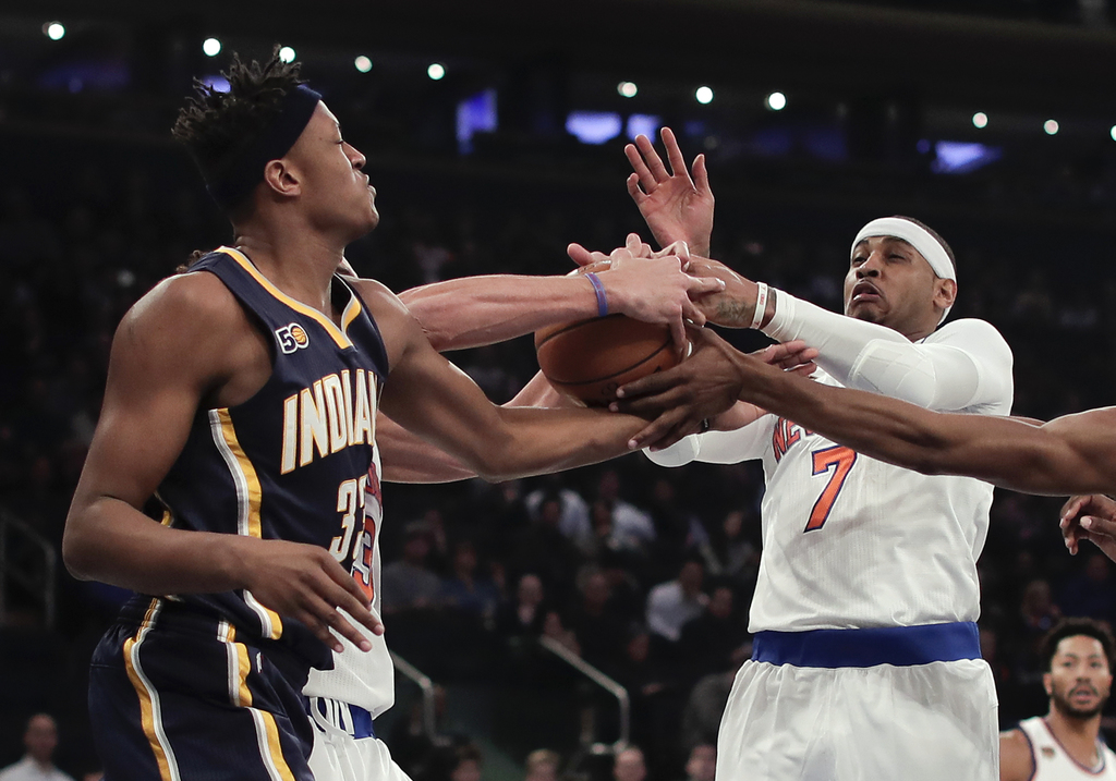 New York Knicks forward Carmelo Anthony (7) and Indiana Pacers center Myles Turner (33) vie for a rebound during the first quarter of a...