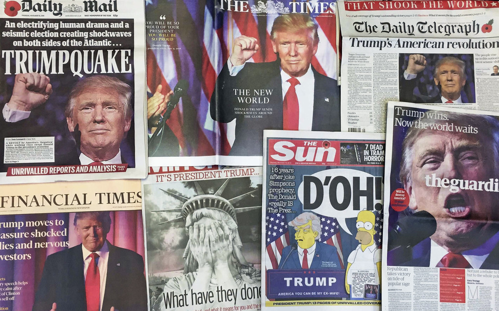 FILE - This Thursday, Nov. 10, 2016 file photo shows the front pages of various British newspapers in London reporting on Donald Trump ...