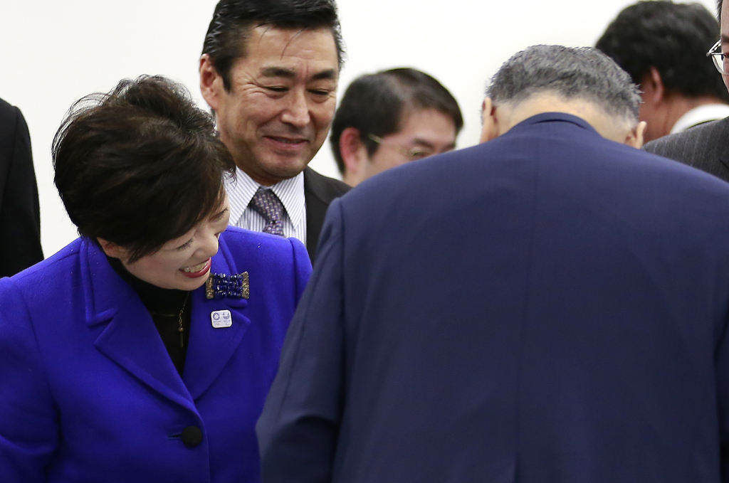 Tokyo Gov. Yuriko Koike greets Tokyo Olympics Organizing Committee President Yoshiro Mori after the four-party working group meeting in...