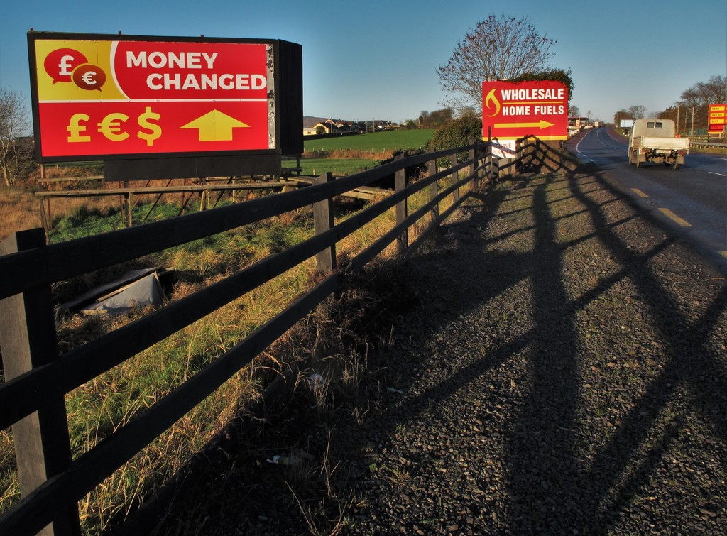 A border crossing south of Newry, Northern Ireland, is marked only by billboards for money-changing kiosks and cut-price fuel in this i...