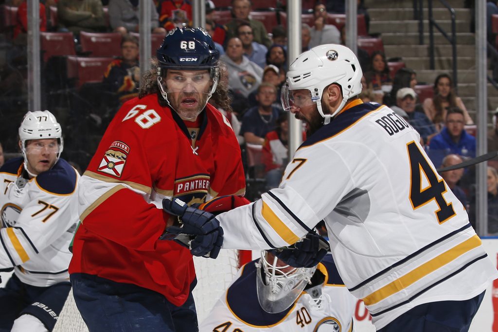 Buffalo Sabres defenseman Zach Bogosian (47) defends against Florida Panthers right wing Jaromir Jagr (68) at the side of the net durin...
