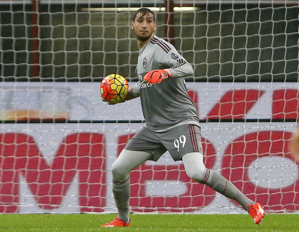FILE - In this Wednesday, Oct. 28, 2015 file photo, AC Milan goalkeeper Gianluigi Donnarumma gets the ball during the Serie A soccer ma...