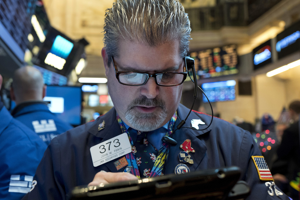 John Panin follows stock prices at the New York Stock Exchange, Wednesday, Dec. 21, 2016, in New York. The Dow is close to the 20,000 m...