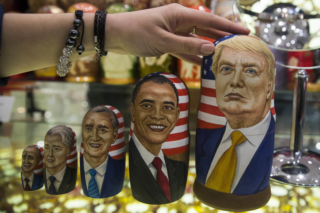 FILE - In this Tuesday, Nov. 8, 2016 file photo, traditional Russian wooden nesting dolls called Matreska depicting U.S. presidents, fr...