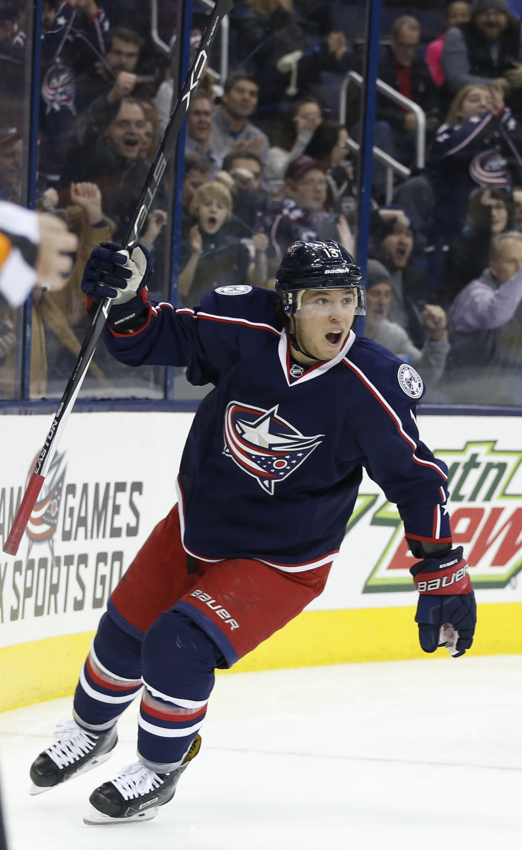 Columbus Blue Jackets' Cam Atkinson celebrates his goal against the Los Angeles Kings during the second period of an NHL hockey game Tu...